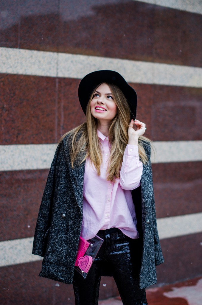 glitter pants pink shirt oversized grey coat black hat snow