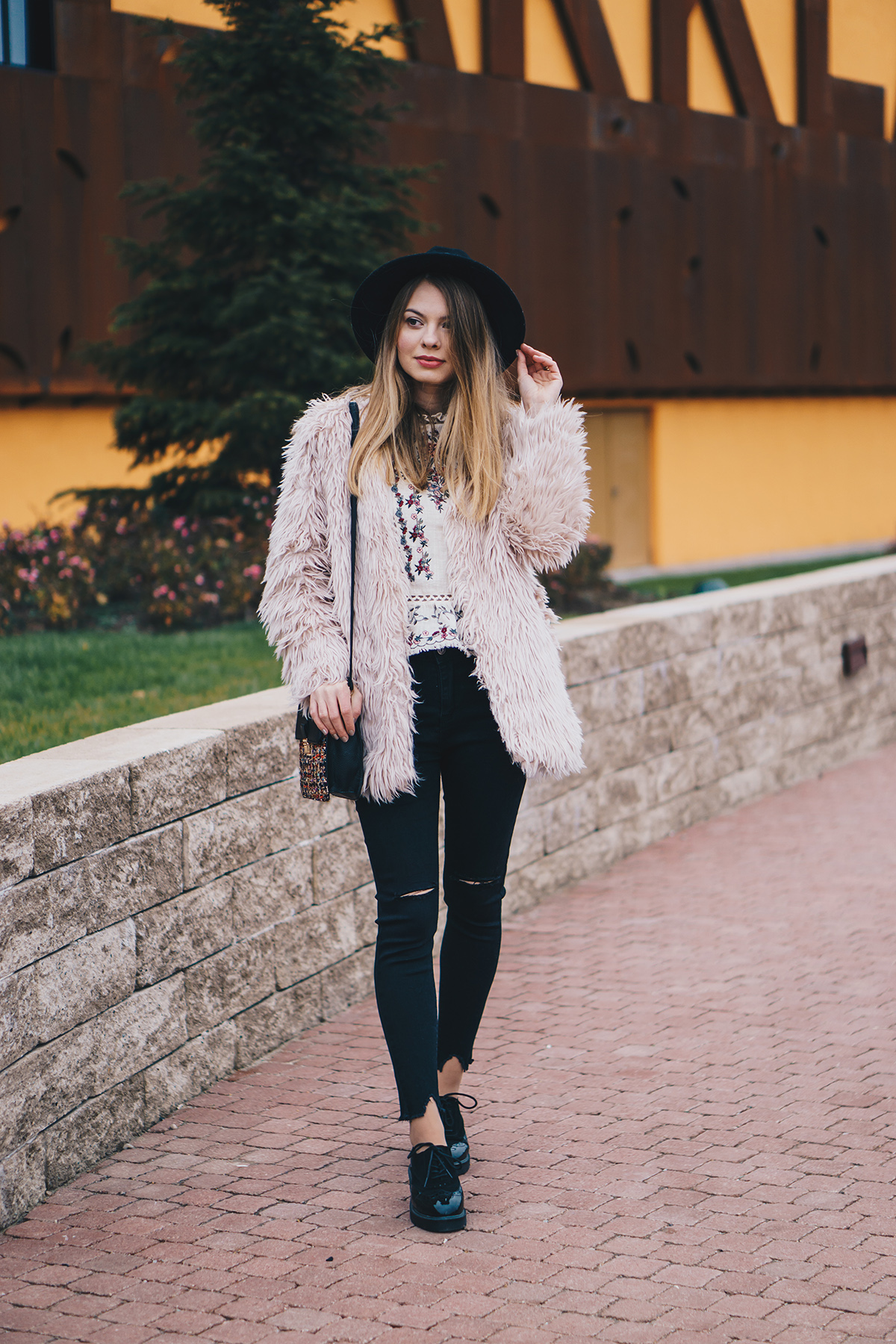 floral-embroidered-blouse-pink-fur-coat-ripped-black-jeans-brogues-winter-outfit-2