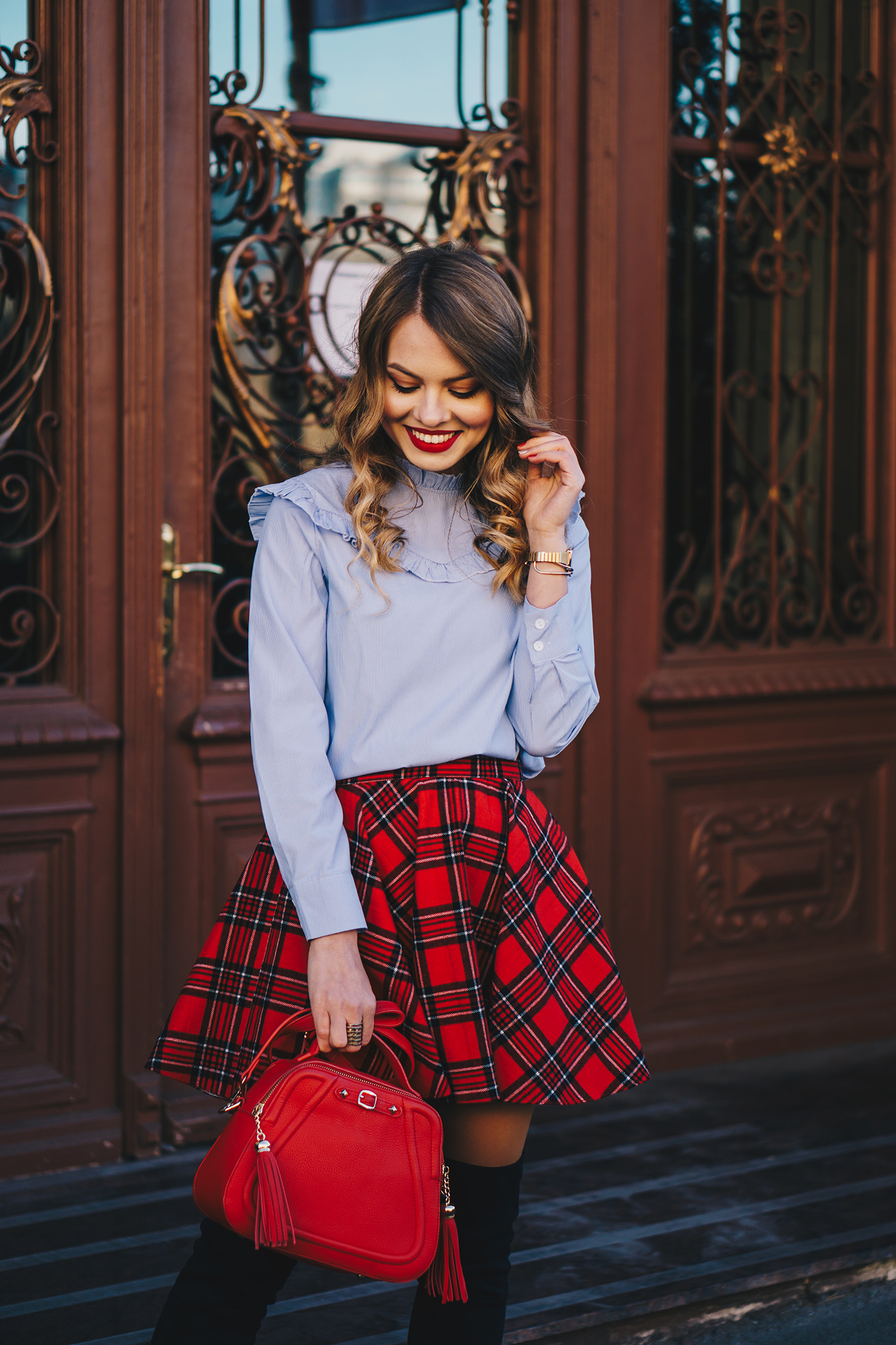 red-plaid-skirt-ruffled-blouse-over-the-knee-boots-christmas-outfit-3