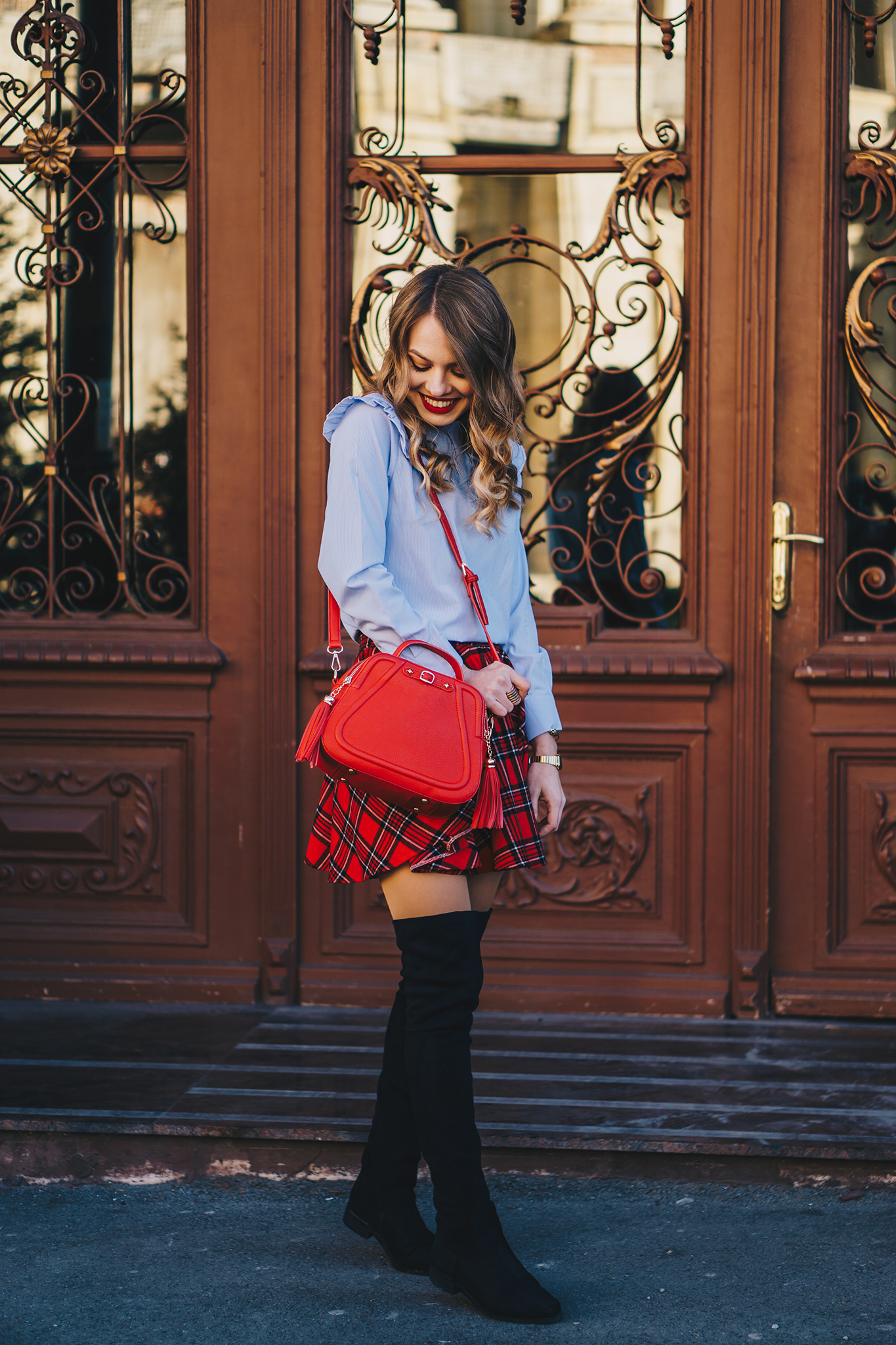 red-plaid-skirt-ruffled-blouse-over-the-knee-boots-christmas-outfit-4
