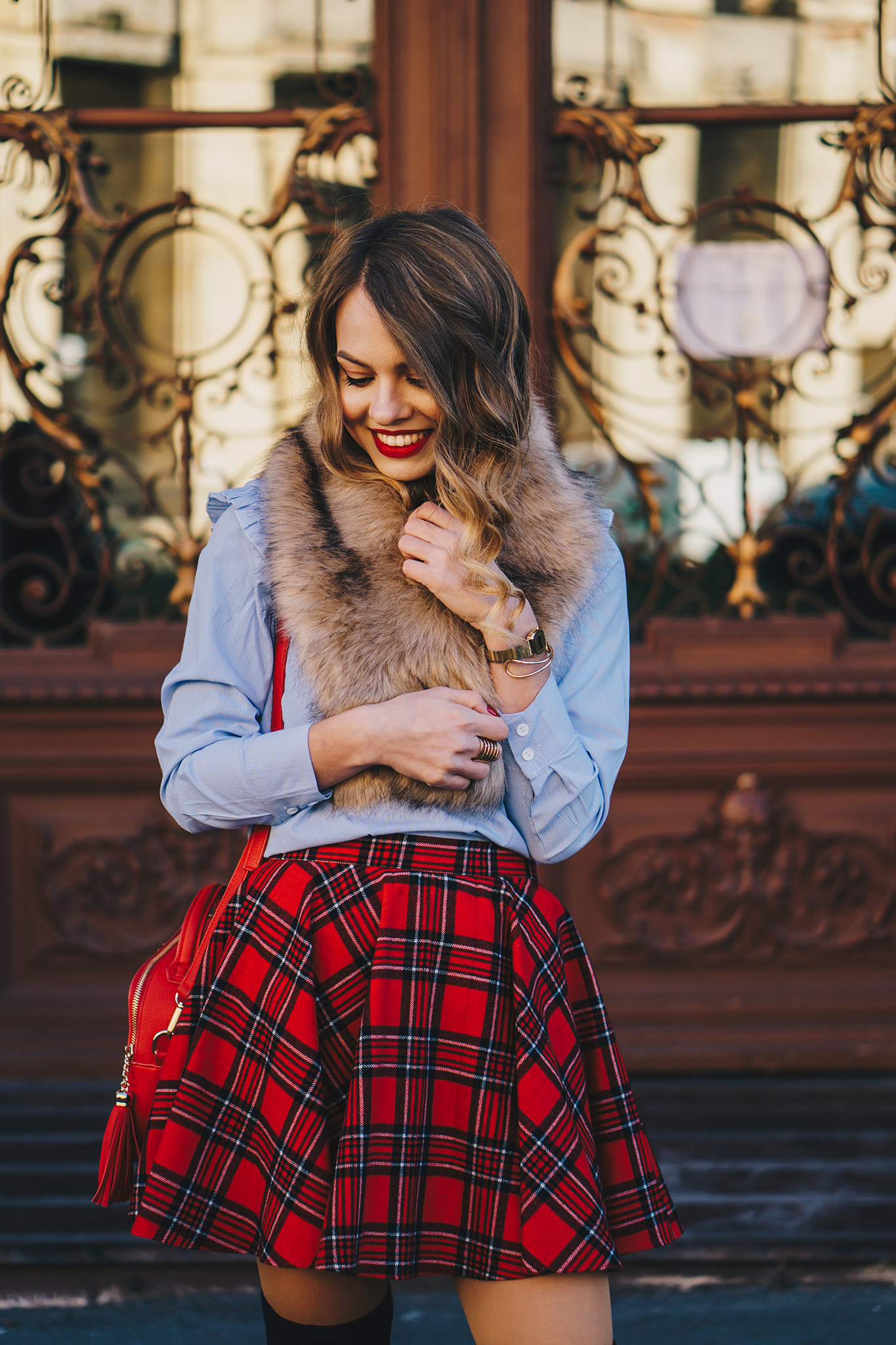 red-plaid-skirt-ruffled-blouse-over-the-knee-boots-christmas-outfit-5