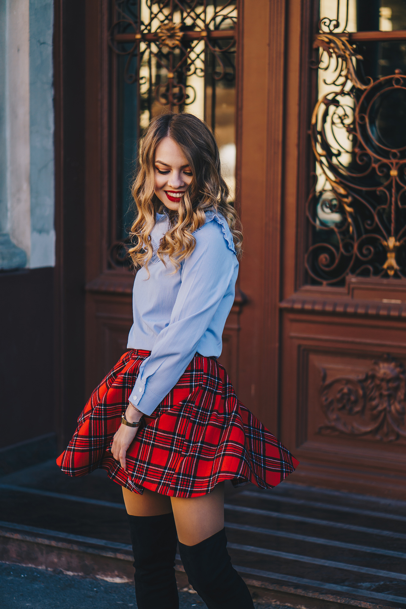red-plaid-skirt-ruffled-blouse-over-the-knee-boots-christmas-outfit-6